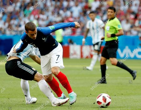Javier Mascherano (L) of Argentina and Antoine Griezmann of France in action during the FIFA World Cup 2018 round of 16 soccer match between France and Argentina in Kazan, Russia, 30 June 2018.