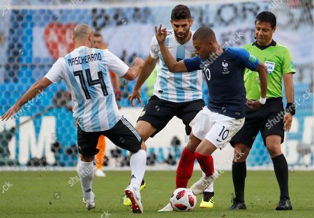 Kylian Mbappe of France and Javier Mascherano of Argentina