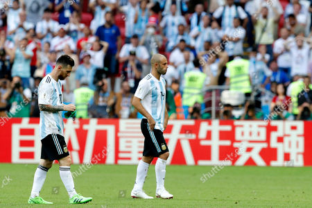 Argentina's Lionel Messi, left, and Argentina's Javier Mascherano leave the field after the round of 16 match between France and Argentina, at the 2018 soccer World Cup at the Kazan Arena in Kazan, Russia