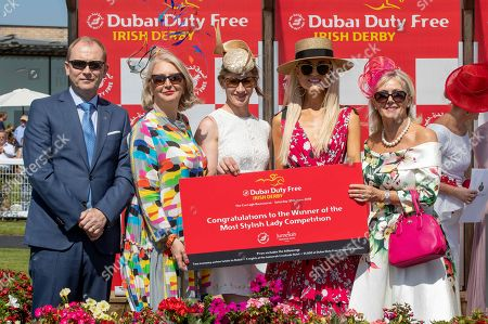 Regina Horan from Malahide - Winner of the Dubai Duty Free Most Stylish Lady with Adrian Mooney from the K-Club. judges, Bairbre Power, Nina Carberry and Breeda McLoughlin