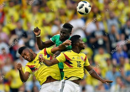 Stock Picture of Senegal's Saliou Ciss, center, jumps for the ball with Colombia's Jefferson Lerma, right, and Colombia's Miguel Borja, left, during the group H match between Senegal and Colombia, at the 2018 soccer World Cup in the Samara Arena in Samara, Russia
