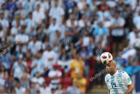 Argentina's Javier Mascherano heads the ball during the round of 16 match between France and Argentina, at the 2018 soccer World Cup at the Kazan Arena in Kazan, Russia
