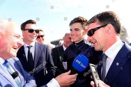 Curragh. Dubai Duty Free Irish Derby. AIDAN O'BRIEN is interviewed on RTE TV by Brian Gleeson after sons JOSEPH (left) and DONNACHA won with LATROBE.