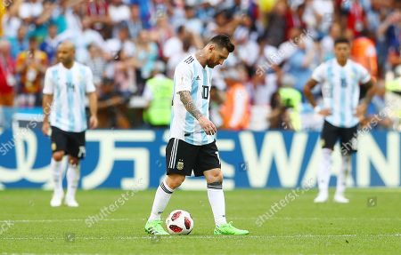 Lionel Messi of Argentina and Javier Mascherano looks dejected after Antoine Griezmann of France scores the opening goal from the penalty spot 1-0