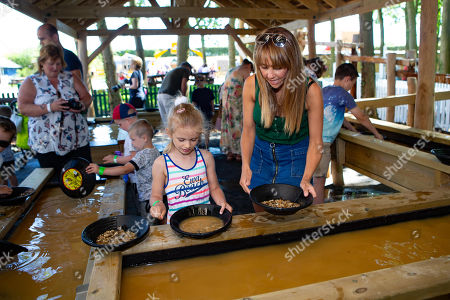 Stock Photo of Samia Longchambon opens Adventure Land and enjoyed panning for treasure with the children