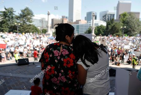 Branda, Kathryn Villa, r m. Brenda Villa, left, comforts her 11-year-old daughter, Kathryn, after speaking during an immigration rally and protest in Civic Center Park, in downtown Denver. The protest was one of hundreds staged nationwide that has brought liberal activists, parents and first-time protesters--motivated by accounts of children separated from their parents at the US-Mexico border--to press President Donald Trump to reunite families quickly