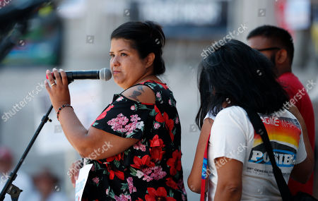 Brenda Villa, r m. Brenda Villa, left, whose husband was deported two years ago, speaks during an immigration rally and protest in Civic Center Park, in downtown Denver. The protest was one of hundreds staged nationwide that has brought liberal activists, parents and first-time protesters--motivated by accounts of children separated from their parents at the US-Mexico border--to press President Donald Trump to reunite families quickly
