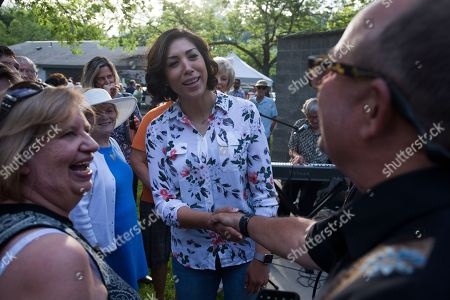 Democratic gubernatorial candidate Paulette Jordan greets attendees during the Idaho District 18 Democrats Campaign Kickoff BBQ in Boise, Idaho