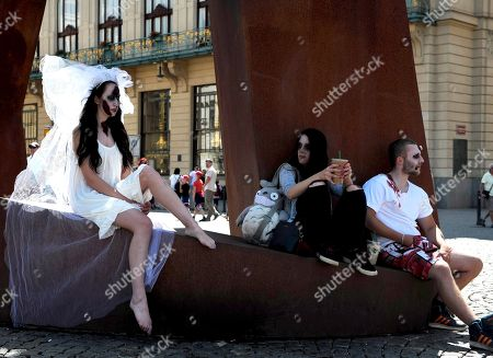 Stock Photo of People dressed up as zombies take part in the Zombie Walk in central Prague.