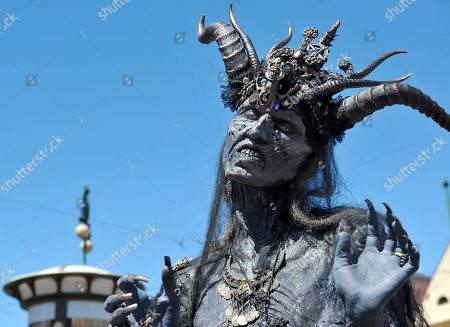 Stock Picture of People dressed up as zombies take part in the Zombie Walk in central Prague.