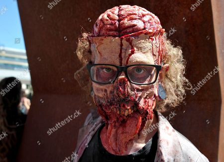 Stock Image of People dressed up as zombies take part in the Zombie Walk in central Prague.