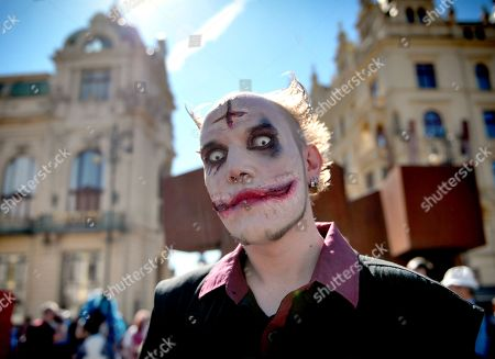 People dressed up as zombies take part in the Zombie Walk in central Prague.