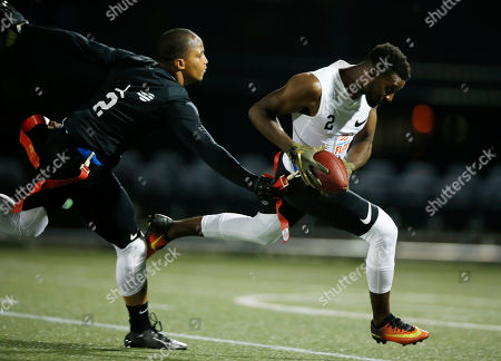 Strong Island Bulldogs' Tim Brown grabs the flag of Fighting Cancer's Turhan Glover during the American Flag Football League (AFFL) U.S. Open of Football tournament, in Pittsburgh
