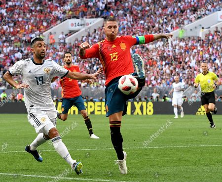 Aleksandr Samedov (L) of Russia and Sergio Ramos of Spain in action during the FIFA World Cup 2018 round of 16 soccer match between Spain and Russia in Moscow, Russia, 01 July 2018.
