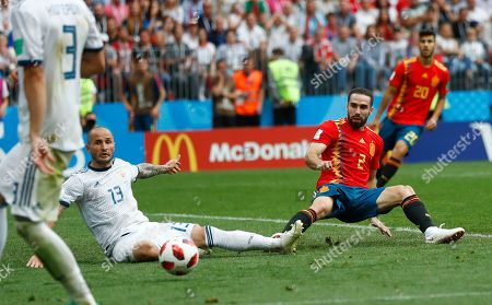 Spain's Dani Carvajal, right, and Russia's Fyodor Kudryashov challenge for the ball during the round of 16 match between Spain and Russia at the 2018 soccer World Cup at the Luzhniki Stadium in Moscow, Russia