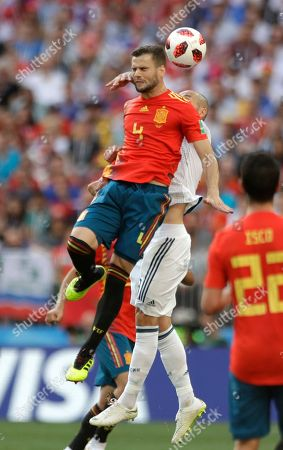 Spain's Nacho, left, and Russia's Fyodor Kudryashov challenge for the ball during the round of 16 match between Spain and Russia at the 2018 soccer World Cup at the Luzhniki Stadium in Moscow, Russia