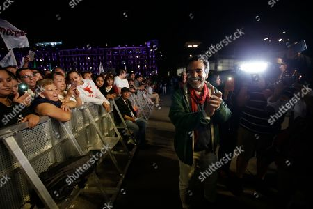 Stock Image of Mexican actor Damian Alcazar cheers as he waits for the arrival of presidential candidate Andres Manuel Lopez Obrador, of the MORENA party, at the main Zocalo plaza in Mexico City, . A prominent exit poll gave populist Andres Manuel Lopez Obrador a 16 to 26 point lead over his nearest rivals, who conceded even before official results were released by the National Electoral Institute