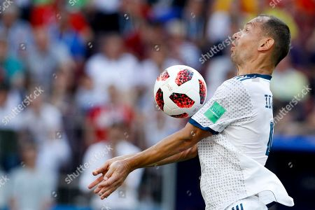 Russia's Sergei Ignashevich controls the ball during the round of 16 match between Spain and Russia at the 2018 soccer World Cup at the Luzhniki Stadium in Moscow, Russia