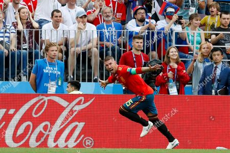 Spain's Sergio Ramos celebrates after Russia's Sergei Ignashevich scored an own goal during the round of 16 match between Spain and Russia at the 2018 soccer World Cup at the Luzhniki Stadium in Moscow, Russia