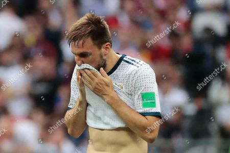 Russia's Vladimir Granat wipes his face during the round of 16 match between Spain and Russia at the 2018 soccer World Cup at the Luzhniki Stadium in Moscow, Russia