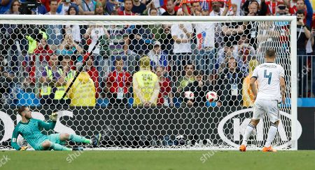Russia's Sergei Ignashevich scores by penalty kick during the round of 16 match between Spain and Russia at the 2018 soccer World Cup at the Luzhniki Stadium in Moscow, Russia