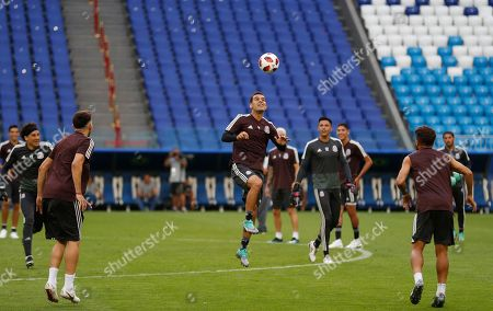 Mexico's Rafael Marquez jumps during Mexico's official training on the eve of the round of 16 match between Brazil and Mexico at the 2018 soccer World Cup in the Samara Arena, in Samara, Russia