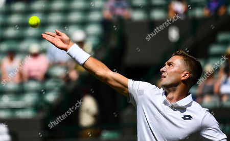 Empty seats can be seen while Liam Broady plays during his first round match