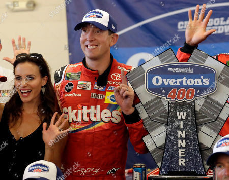 Kyle Busch, Samantha Busch. Kyle Busch, right, and his wife Samantha Busch celebrate with the trophy in Victory Lane after his win in a NASCAR Cup Series auto race at Chicagoland Speedway in Joliet, Ill