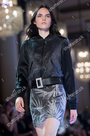 Stock Image of A model presents a creation from the Fall/Winter 2018/19 Haute Couture collection by French designer Maxime Simoens for Azzaro Couture during the Paris Fashion Week, in Paris, France, 01 July 2018. The presentation of the Haute Couture collections runs from 01 to 05 July.