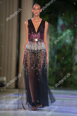 Stock Photo of A model presents a creation from the Fall/Winter 2018/19 Haute Couture collection by French designer Maxime Simoens for Azzaro Couture during the Paris Fashion Week, in Paris, France, 01 July 2018. The presentation of the Haute Couture collections runs from 01 to 05 July.