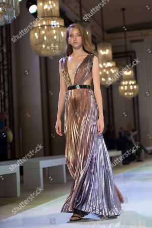 A model presents a creation from the Fall/Winter 2018/19 Haute Couture collection by French designer Maxime Simoens for Azzaro Couture during the Paris Fashion Week, in Paris, France, 01 July 2018. The presentation of the Haute Couture collections runs from 01 to 05 July.