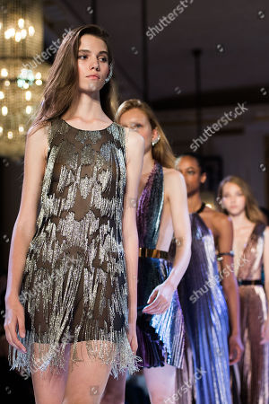 Models present creations from the Fall/Winter 2018/19 Haute Couture collection by French designer Maxime Simoens for Azzaro Couture during the Paris Fashion Week, in Paris, France, 01 July 2018. The presentation of the Haute Couture collections runs from 01 to 05 July.