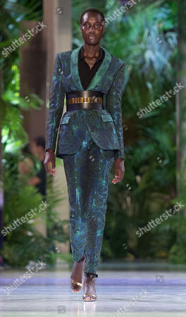 Stock Picture of A model presents a creation from the Fall/Winter 2018/19 Haute Couture collection by French designer Maxime Simoens for Azzaro Couture during the Paris Fashion Week, in Paris, France, 01 July 2018. The presentation of the Haute Couture collections runs from 01 to 05 July.