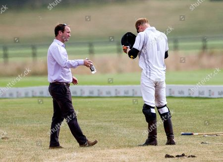 Polo manager Andrew Tucker cleans glasses of Prince Harry at half time