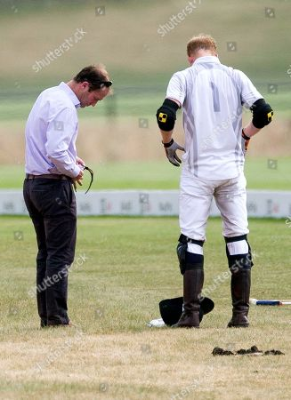 Stock Image of Polo manager Andrew Tucker cleans glasses of Prince Harry at half time