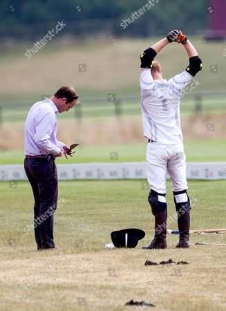 Stock Photo of Polo manager Andrew Tucker cleans glasses of Prince Harry at half time
