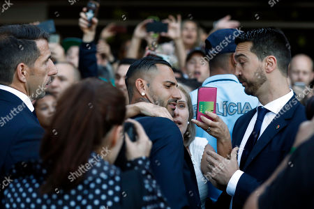 Portugal's Ricardo Quaresma (C) take a picture with a fan at his arrival at Humberto Delgado airport in Lisbon, Portugal, 01 July 2018. After defeat against Uruguay, the Portugal national soccer team was eliminated from the FIFA World Cup 2018 round of 16.