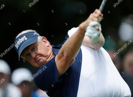Stock Photo of Colin Montgomerie hits off the first tee during the final round of the U.S. Senior Open golf tournament at The Broadmoor, in Colorado Springs, Colo