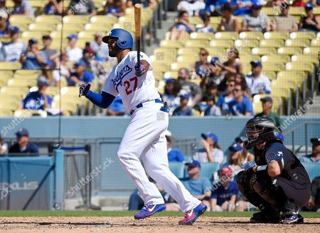Matt Kemp, Tom Murphy. Los Angeles Dodgers' Matt Kemp, left, hits a solo home run as Colorado Rockies catcher Tom Murphy watches during the eighth inning of a baseball game, in Los Angeles