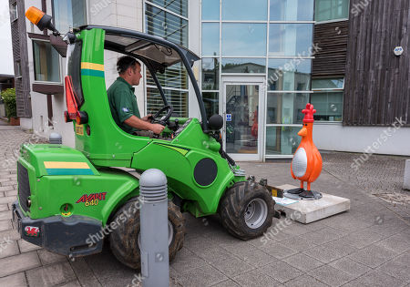 """The """"Oh Bollards"""" Feathers McGraw character (disguised as a traffic cone) is installed outside Aardman Animations at Bristol Harbourside for the Gromit Unleashed 2 sculpture trail. Gromit Unleashed 2 which officially begins on 02 July will see the Academy Award®-winning character Gromit by Nick Park at Aardman Animations returning to Bristol in 2018 for the second time on sculpture trails to raise money for  the Grand Appeal charity. The character of Gromit will be joined by Wallace and their arch nemesis Feathers McGraw."""