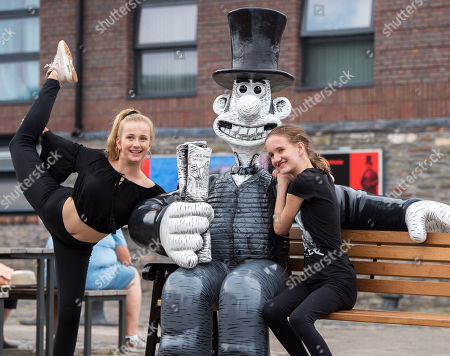"""Chantelle Watson and Miriam Curzon both aged 13 (verbal permission given for photo) pose with the """"Wallambard"""" Wallace character (after Isambard Kingdom Brunel) installed outside the SS Great Britain at Bristol Harbourside for the Gromit Unleashed 2 sculpture trail. Gromit Unleashed 2 which officially begins on 02 July will see the Academy Award®-winning character Gromit by Nick Park at Aardman Animations returning to Bristol in 2018 for the second time on sculpture trails to raise money for  the Grand Appeal charity. The character of Gromit will be joined by Wallace and their arch nemesis Feathers McGraw."""