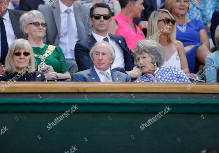 Sir Jackie Stewart, center, former racing world champion sits in the royal box on center court during the Men's Singles first round match between Roger Federer of Switzerland and Serbia's Dusan Lajovic at the Wimbledon Tennis Championships in London