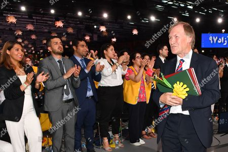 Sir David Amess MP receives applause after speaking on stage with the British delegation during the annual gathering of Free Iran-Alternative 100 ASHRAF at the Villepinte exhibition North of Paris, France