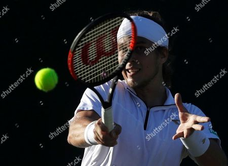Lukas Lacko of Slovakia returns a ball to Benjamin Bonzi of France during the Men's Singles first round match at the Wimbledon Tennis Championships in London