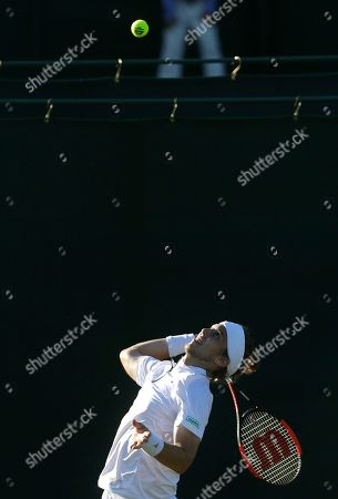 Lukas Lacko of Slovakia serves to Benjamin Bonzi of France during the Men's Singles first round match at the Wimbledon Tennis Championships in London