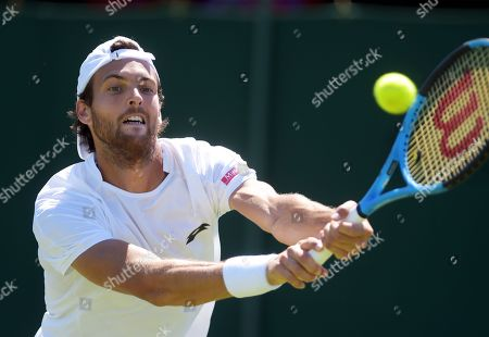 Joao Sousa of Portugal returns to Sergiy Stakhovsky of Ukraine during their first round match at the Wimbledon Championships at the All England Lawn Tennis Club, in London, Britain, 02 July 2018.