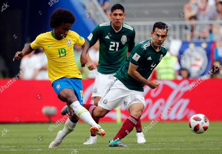 Willian of Brazil and Rafael Marquez of Mexico