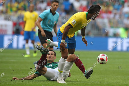 Brazil's Paulinho, right, vies for the ball with Mexico's Rafael Marquez during the round of 16 match between Brazil and Mexico at the 2018 soccer World Cup in the Samara Arena, in Samara, Russia