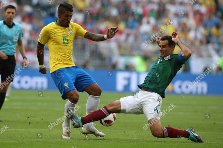 Brazil's Paulinho, left, vies for the ball with Mexico's Rafael Marquez during the round of 16 match between Brazil and Mexico at the 2018 soccer World Cup in the Samara Arena, in Samara, Russia