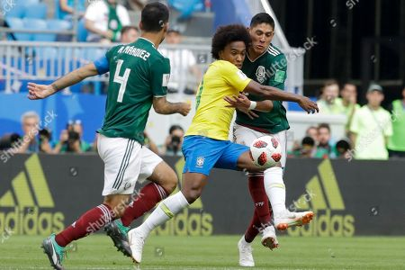 Brazil's Taison, center, vies for the ball with Mexico's Edson Alvarez, right, and Mexico's Rafael Marquez, left, during the round of 16 match between Brazil and Mexico at the 2018 soccer World Cup in the Samara Arena, in Samara, Russia